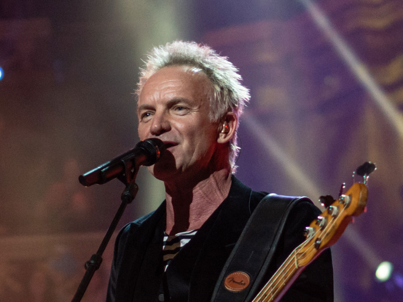 Photo of Sting playing guitar.