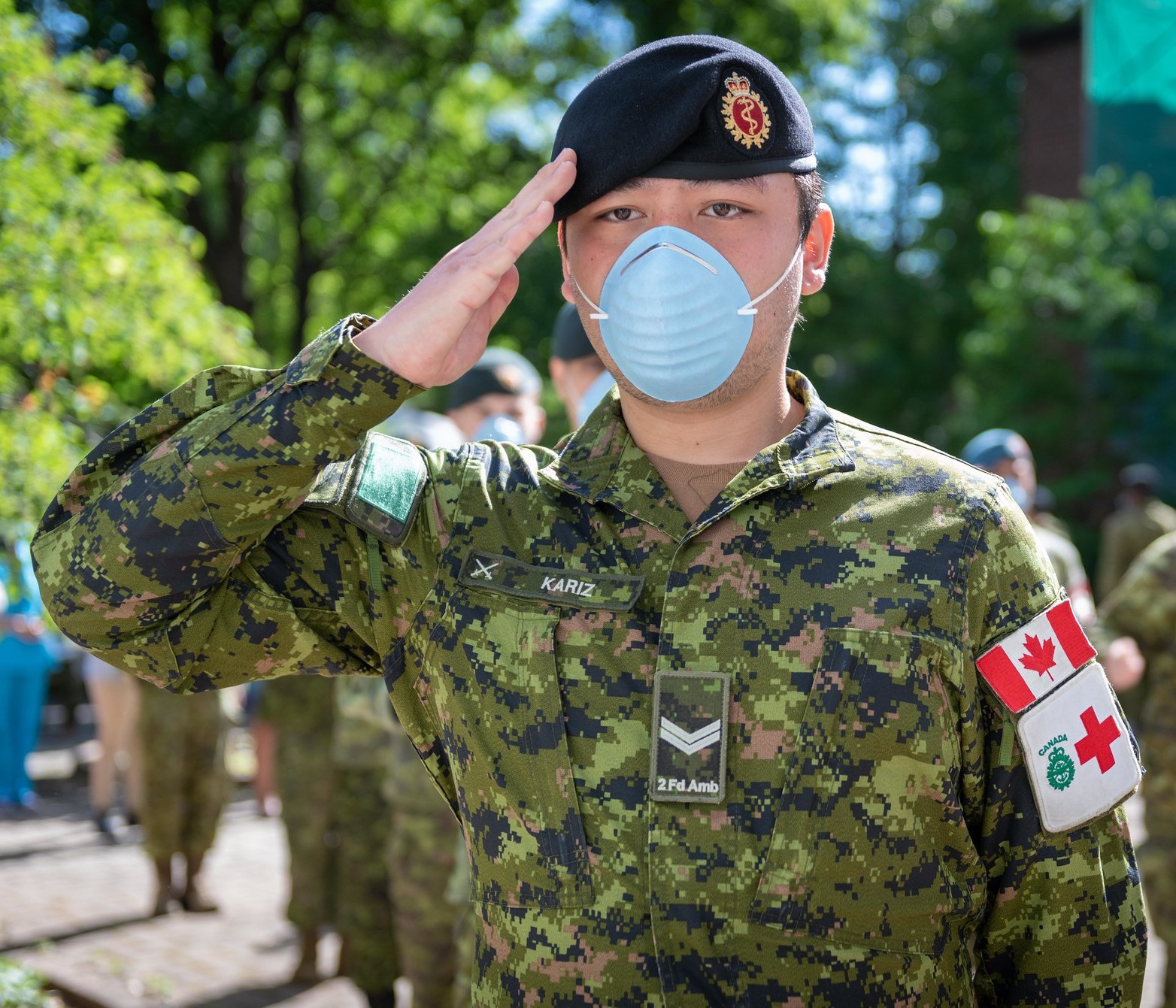 medical technician from 2nd Field Ambulance, salutes during a departure ceremony at a long-term care facility in Montreal, QC